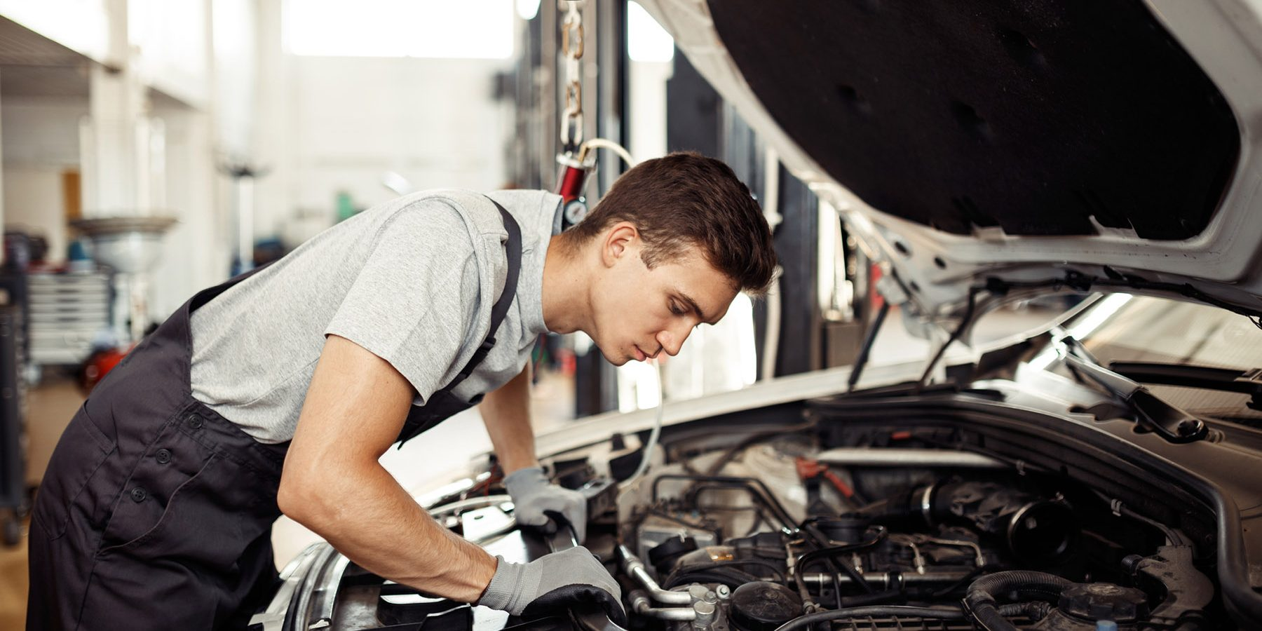 Mechanic Langport | Technician checking engine of car. Auto mechanic checking car engine. Maintenance checking car.